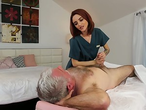 Scrumptious red haired masseuse Lola Fae gets intimate with old client