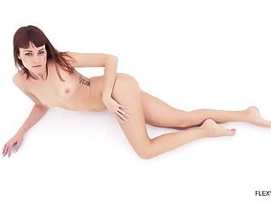 Beautiful girl in a bodysuit bends the brush body in beautiful ways