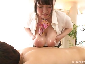 Broad in the beam Japanese secretary Mochida Yukari oils up her tits for a titjob
