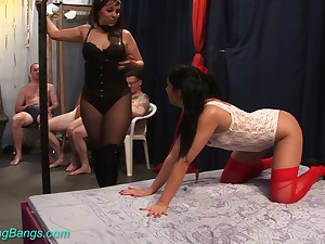 Versatile dark haired hoe Julia tries to suck as many cocks as possible