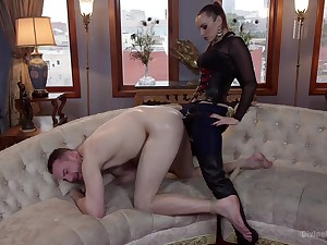 Strap-on anal for her male slave before sitting aloft his face